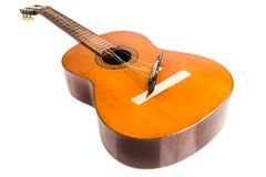 Broken classical guitar with detached bridge isolated in white b Stock Photo
