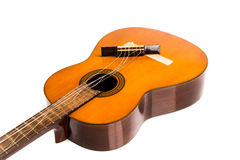 Broken classical guitar with detached bridge isolated in white b Royalty Free Stock Photos