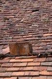 Broken clay shingle roof Royalty Free Stock Photography