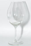 Broken clear wineglass with sharp glass fragments  Royalty Free Stock Photo