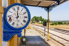 Broken clock in the deactivated train station of Crato. Royalty Free Stock Photo