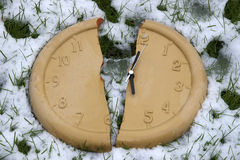 Broken clock face in the snow Stock Photo
