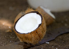 Broken coconut in closeup Royalty Free Stock Photo
