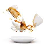 Broken coffee mug. With splash of coffee. Isolated on white Royalty Free Stock Photo