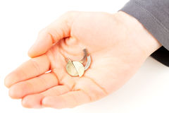 Broken coin in hand Royalty Free Stock Photography