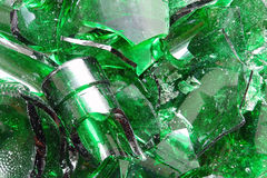 Broken color glass. Background of green glass broken into pieces Royalty Free Stock Image