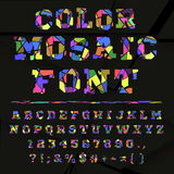 Broken colored alphabet on a dark background Royalty Free Stock Photo