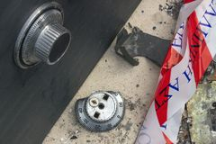 Broken combination lock on the safe closeup. Police tape.  Conc. Ept -  burglary, robbery,  crime Royalty Free Stock Images
