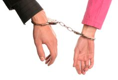 Broken commitment. Marriage/relationship concept, male and female handcuffed, isolated on white Stock Image
