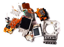 Broken compact digital camera parts prepared. Royalty Free Stock Photos