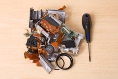 Broken compact digital camera spare parts Royalty Free Stock Photos