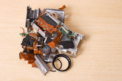 Broken compact digital camera spare parts isolated on white Stock Image