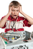 Broken computer. The child is experiencing. Royalty Free Stock Image