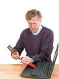 Broken computer repair - man with laptop. Frustrated user attacking broken laptop with hammer royalty free stock photo
