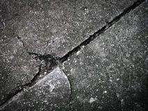 Broken concrete. Broken old used cracked and grey concrete Stock Photography