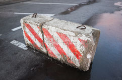 Broken concrete road block with striped pattern Stock Photography