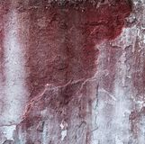 Broken concrete wall and faded red paint Royalty Free Stock Photography