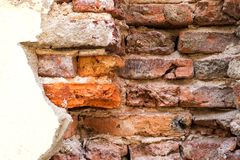 Broken concrete wall of the house show old brick wall stock image