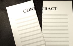 Broken Contract. A broken contract sheet of paper on leather background Stock Photo