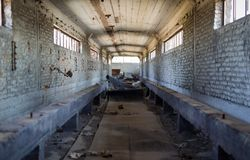 Broken conveyor belt in an abandoned port facility Royalty Free Stock Images