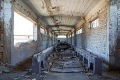 Broken conveyor belt in an abandoned port facility Stock Images