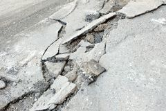 Broken cracked asphalt pavement in Russia. Stock Image