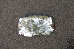 Broken and Cracked Car or Motorcycle Mirror Lies on the Road. Accident on the road. Safe Driving of Transport, Rules of Road. Traffic stock photo
