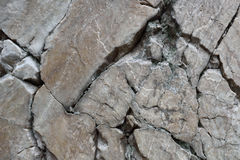 Broken and cracked quartzite rock Stock Images