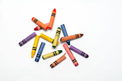 Broken crayons. Laying on a white sheet of paper royalty free stock photos