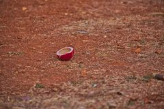 Broken Cricket Ball. This is a picture of a broken cricket ball that represents the efforts of player on a red sand field stock images