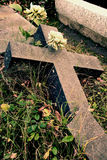 Broken cross. Broken granite cross in a cemetery royalty free stock images