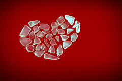Broken crystal heart on red Stock Image