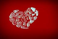 Broken crystal heart on red. Broken crystal heart shape on red background stock image