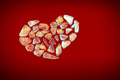 Broken crystall heart with flame on red Stock Images