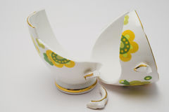 Broken cup. Pieces of a broken fine china cup Royalty Free Stock Images