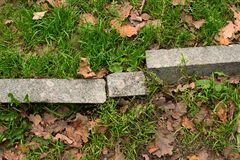Broken curb. In the park Royalty Free Stock Photos