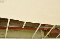 Broken and damage home ceiling falling down to ground. Broken and damage home ceiling falling down to the ground Royalty Free Stock Photography