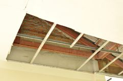Broken and damage home ceiling falling down to ground. Broken and damage home ceiling falling down to the ground Royalty Free Stock Images