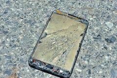 Broken damage  mobile in sun light Stock Images