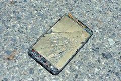 Broken damage  mobile in sun light Royalty Free Stock Image