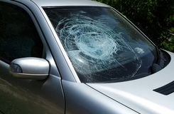 Broken damaged car windshield glass window. royalty free stock images