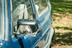 Broken and damaged side mirror on the old rusty car doors with remaining wires and duct tape holding plastic frame without glass stock photos
