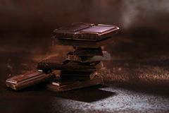 Broken dark chocolate and coffee beans royalty free stock image