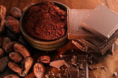 Broken dark chocolate and coffee beans royalty free stock photo