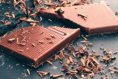 Broken dark chocolate stock image