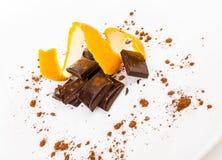 Broken dark chocolate with orange peel.  Stock Images