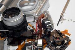Broken digital camera Stock Images