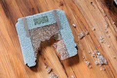 Broken digital human scale on the floor. Broken glassy digital scale for measuring people. royalty free stock image