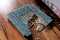 Broken digital human scale on the floor. Broken glassy digital scale for measuring people. stock image