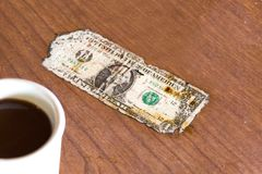 An old one dollar bill on a table. Royalty Free Stock Photo